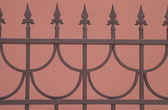 Decorative Sharp bronze fence isolated on brown — Stock Photo