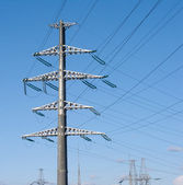 High-voltage power line metal towers — Stock Photo