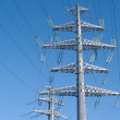 High-voltage power line grey metal props — Stock Photo
