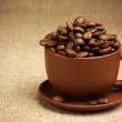 Cup with coffee beans - Stock Photo