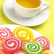 Colorful candy and tea - Stock Photo