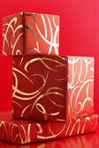 Red ornamented gifts — Stock Photo