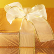 Stock Photo: Gold foil gift