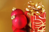 Christmas-tree decorations and gift — Stock Photo