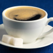 Cup of coffee and sugar - Stock Photo