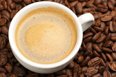 Cup of coffee and coffee beans — Stock Photo
