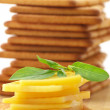 Crackers with cheese and basil - Stock Photo