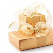 Stock Photo: Gold foil gifts