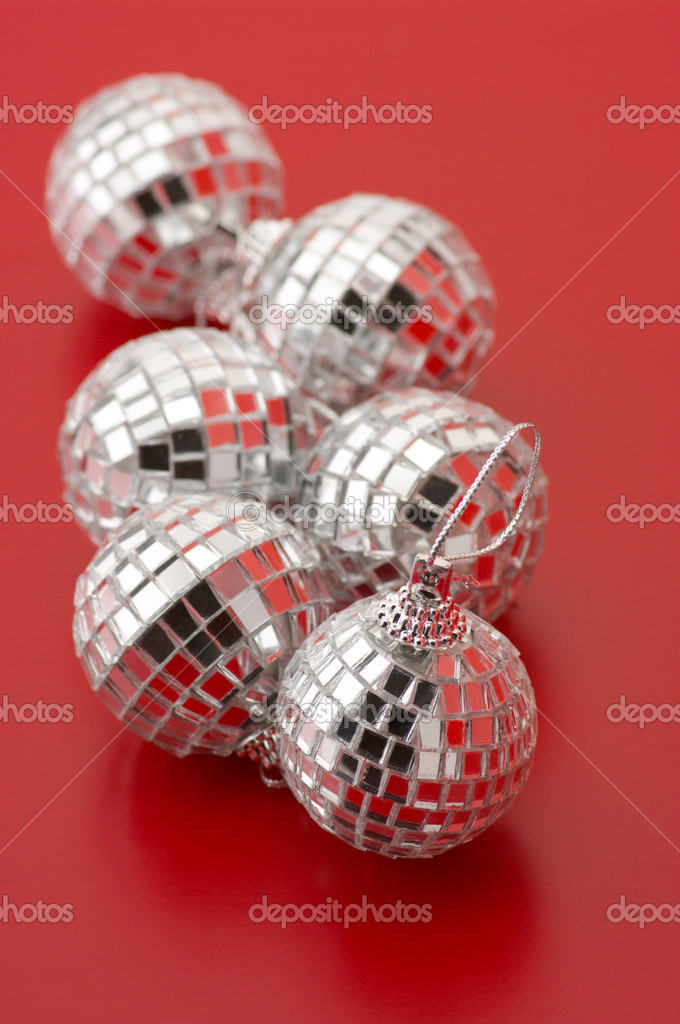 Group of Christmas disco balls on red background. — Stock Photo #4144046