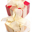 Red and gold foil gifts — Stock Photo