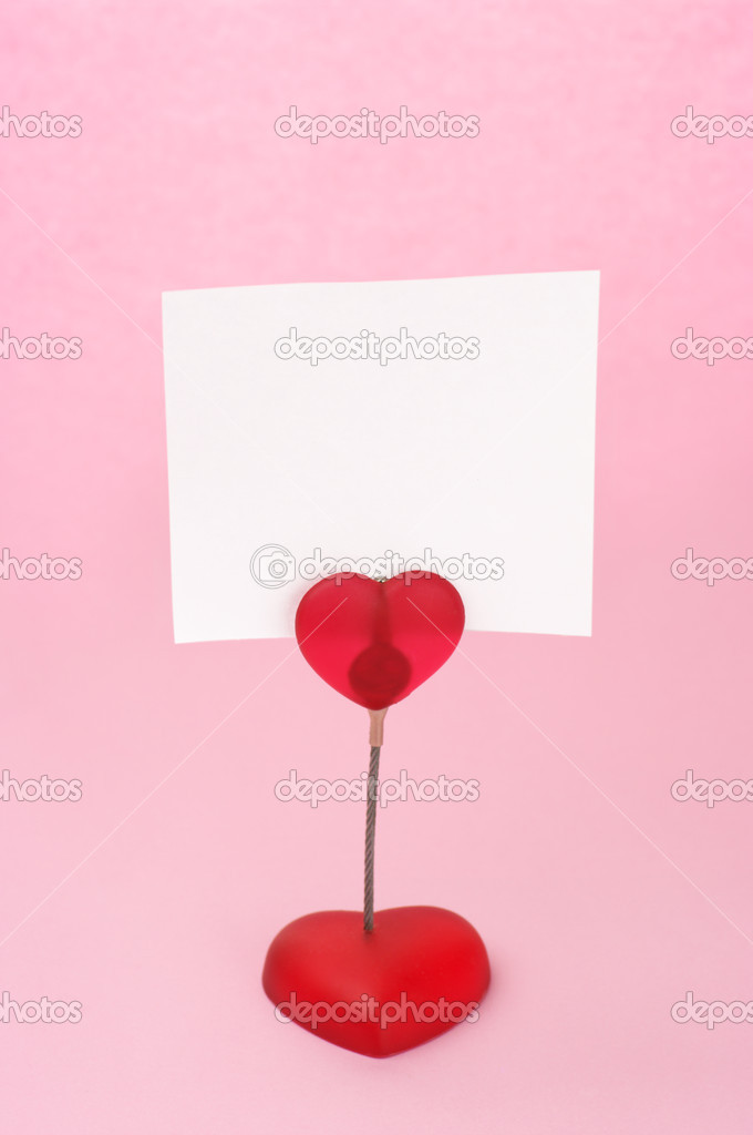 Red heart shaped note holder with blank sheet on pink background. — Stock Photo #4253098