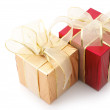 Stock Photo: Red and gold foil gifts
