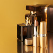 Stock Photo: Cosmetics on gold