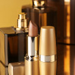 Cosmetics on gold — Stock Photo