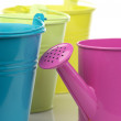Colorful buckets and watering can - Stock Photo