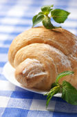 Croissant on plate — Stock Photo