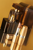 Cosmetics on gold — Stock Photo