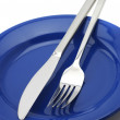 Silverware on plate - Stock Photo