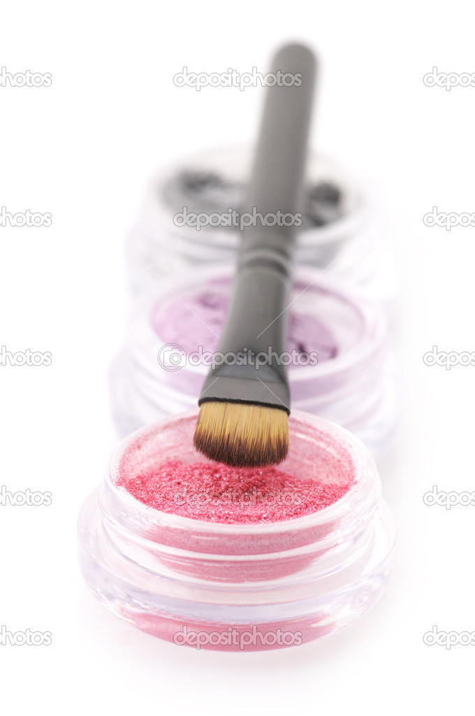 Set of powder eye shadows in jars with brush isolated on white background. — Stock Photo #4828336