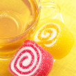 colorful candy and tea — Stock Photo
