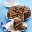 Homemade chocolate cake and coffee — Stock Photo