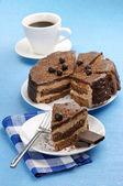 Homemade chocolate cake and coffee — Stock Photo