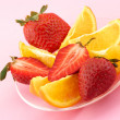 Strawberry and citrus slices - Stock Photo