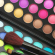 Eye shadows palette and brushes — Stock Photo
