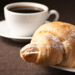 Royalty-Free Stock Photo: Croissant and black coffee