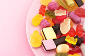 Assorted candy in plate — Stock Photo