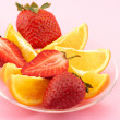 Strawberry and citrus slices — Stock Photo