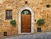 Porte de la maison ancienne, pienza, Toscane, Italie — Photo
