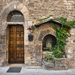 Old house door, Assisi, Umbria, Italy - Stock Photo
