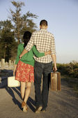 Couple walking with luggage in hand — Stock Photo