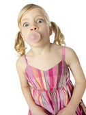 Young girl blowing bubble with gum — Stock Photo