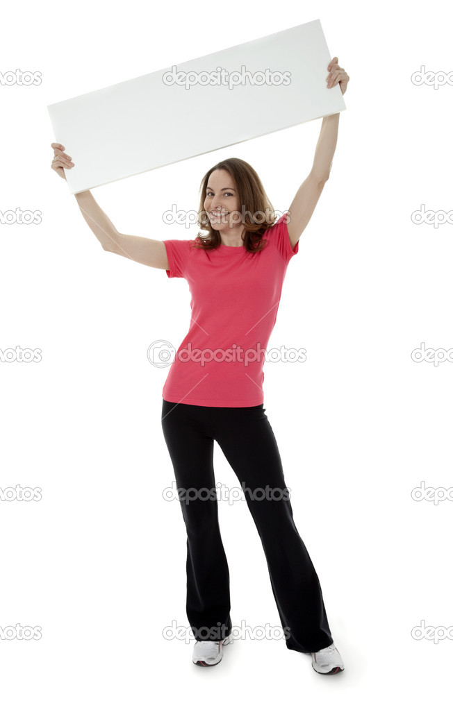 Full length view of pretty brunette woman holding blank sign overhead on white background.  Stock Photo #4912683