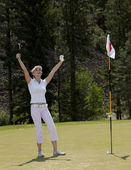 A Woman's Day at the Golf Coursed — Stockfoto