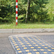 Stock Photo: Obstacle inl road for restriction of speed