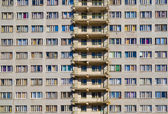 Wall of an apartment house, many windows — Stock Photo
