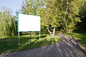 Clear billboard in forest — Stock Photo