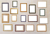 Many various photo frames hang on a wall. — Stock Photo