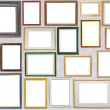 Various wooden photo frames hang on a wall — Stock Photo #4907570