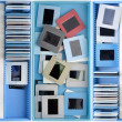 Boxes with old dusty slides — Stock Photo
