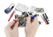 Repair of a digital video camera — Stock Photo