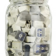 Stock Photo: Glass jar with buttons from standart keyboards