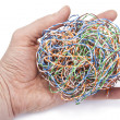 Hand holds ball from a  internet cable - Stock Photo
