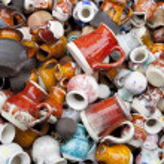 Small ceramic jugs and cups macro — Stock Photo