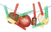 Cheese, bread, sausage and apple hang on a rope — Stock Photo