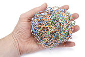 Hand holds ball from a internet cable — Stock Photo