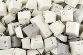 Heap of keys and buttons background — Stockfoto